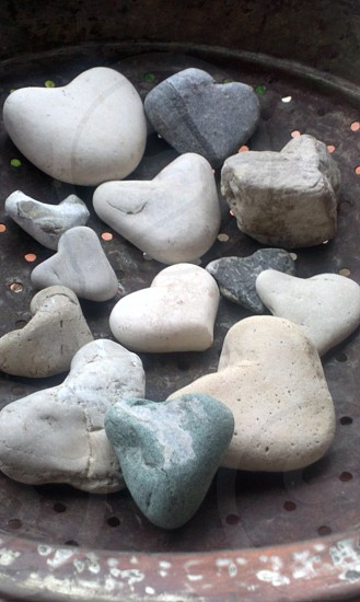 gray black and white hearts shape stones on gray metal photo