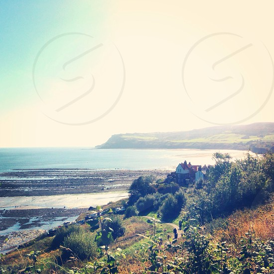 Robin hoods bay whitby coastal sea England green countryside walk path  photo