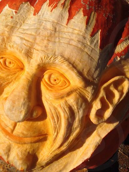 human head rock sculpture photo