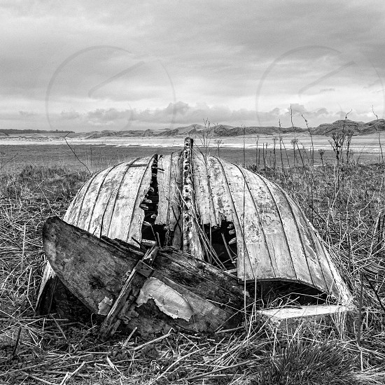Old weathered boat on the shore.  Nautical photo. photo