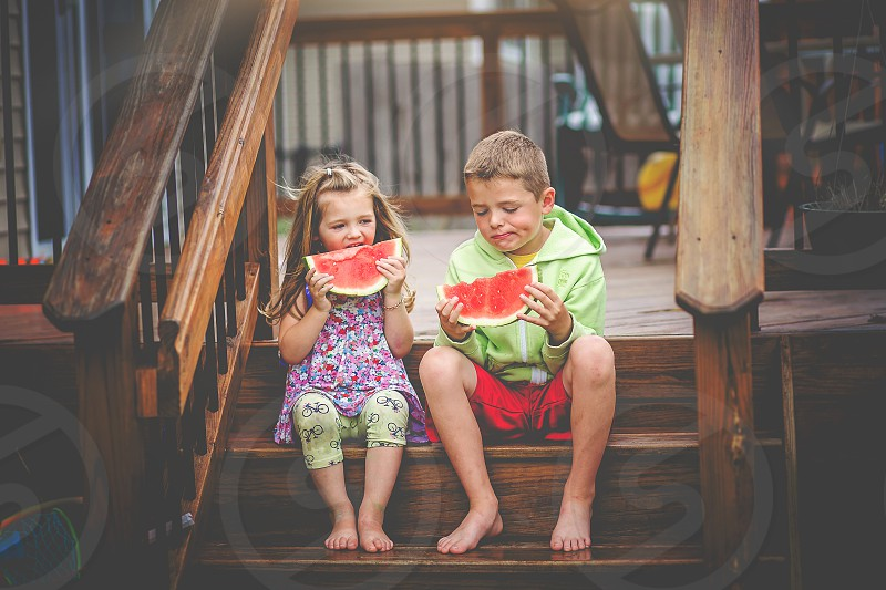 Snacking on Watermelon watermelon summer warm days snack kids children photo