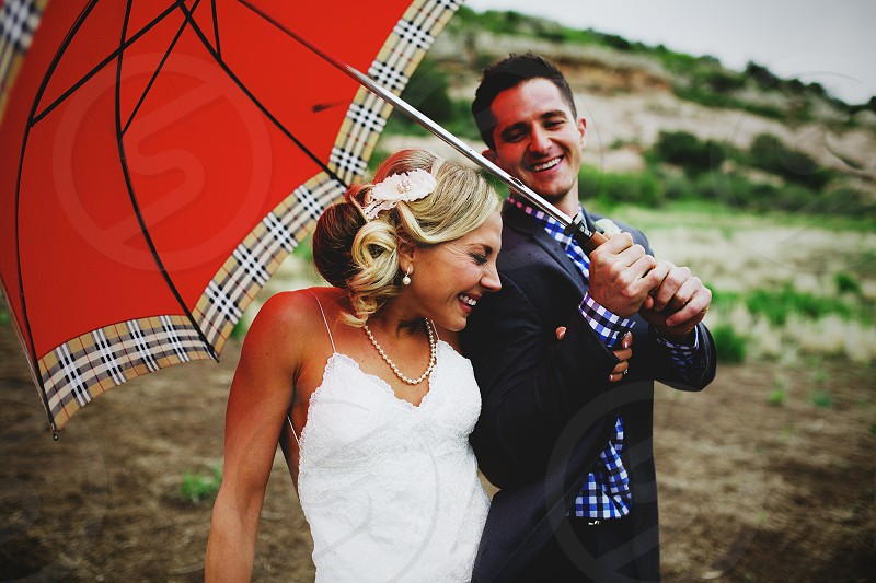 wedding bride groom foothills colorado rainy rainy wedding day storm umbrella natural light photo