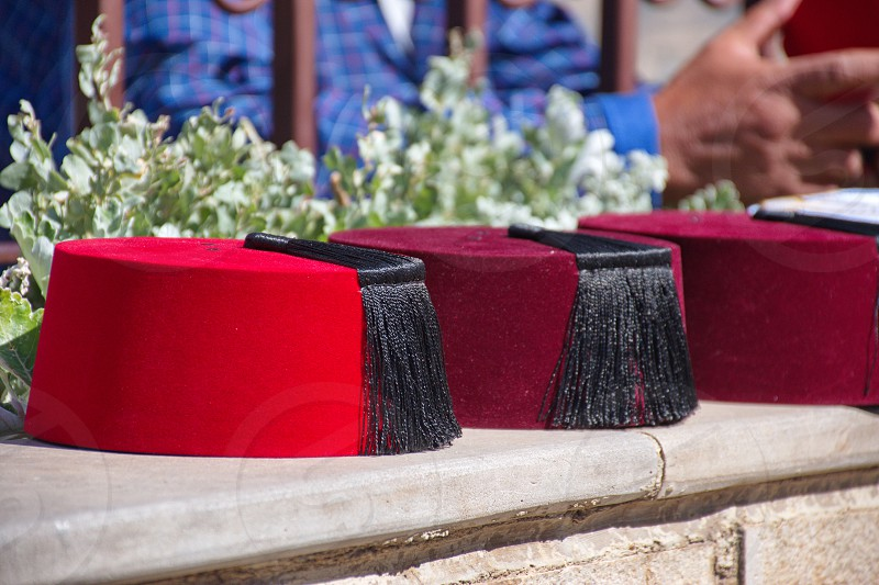 Closeup of traditional cap put for sale near Fes in Morocco photo