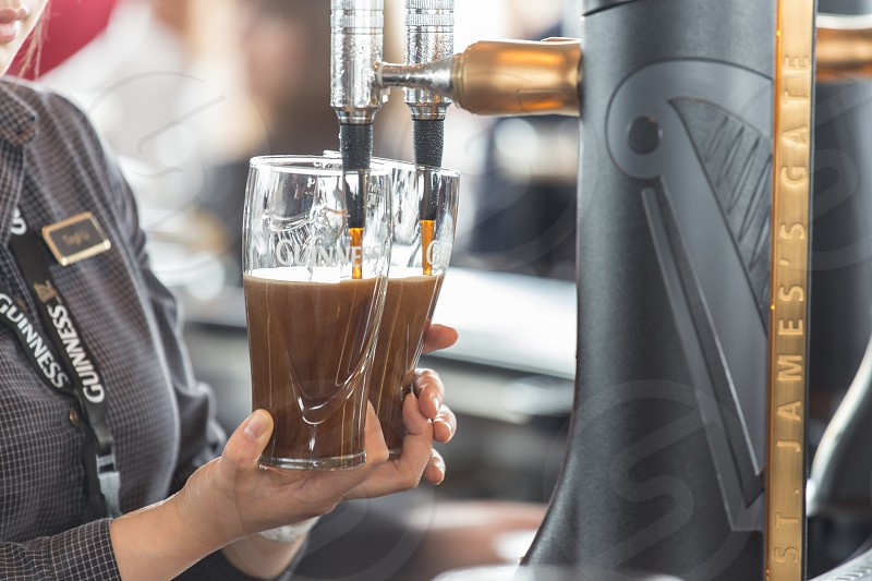 Pouring a perfect pint of Guinness at the Guinness Storehouse.  Dublin Ireland. photo