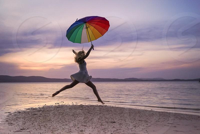 Movement dance dancing girl dress lake sunset rainbow umbrella  photo
