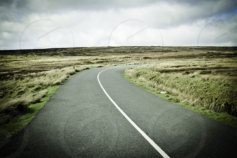 Winding road landscape image taken atop the Wicklow mountains in Ireland. photo