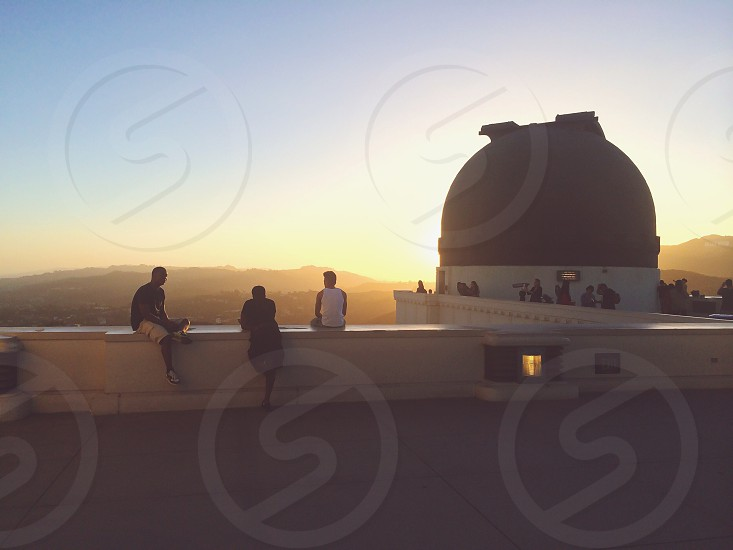 people sitting near domed building photo