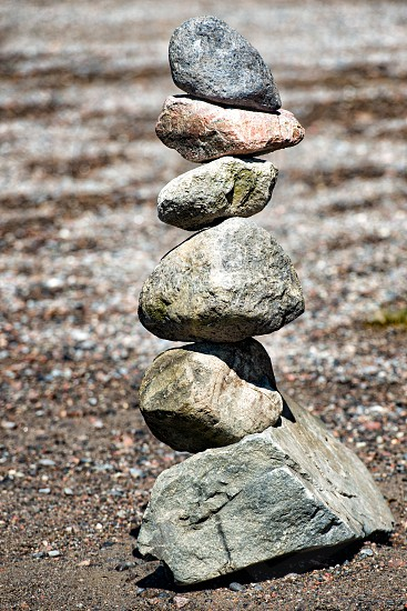 Rocks in equilibrium on the sand photo