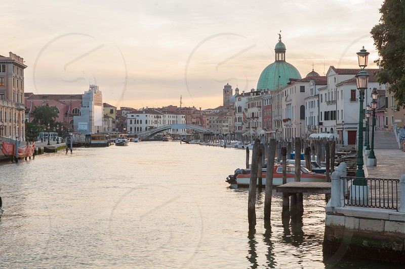 Gorgeous view of the Grand Canal and Basilica Santa Maria della Salute during sunset with clouds Venice Italy. photo