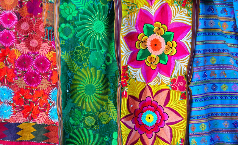 Mexican colorful serape traditional embroidery colorful fabrics photo