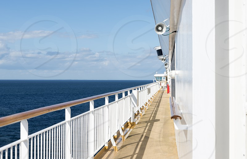 travel with cruise ship over the blue sea with horizon as background photo