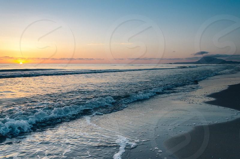 Sunset on the mediterranean sea at the beach photo