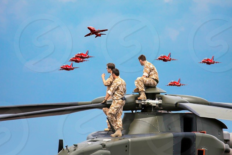 Helicopter Crew Watching the Red Arrows Display photo
