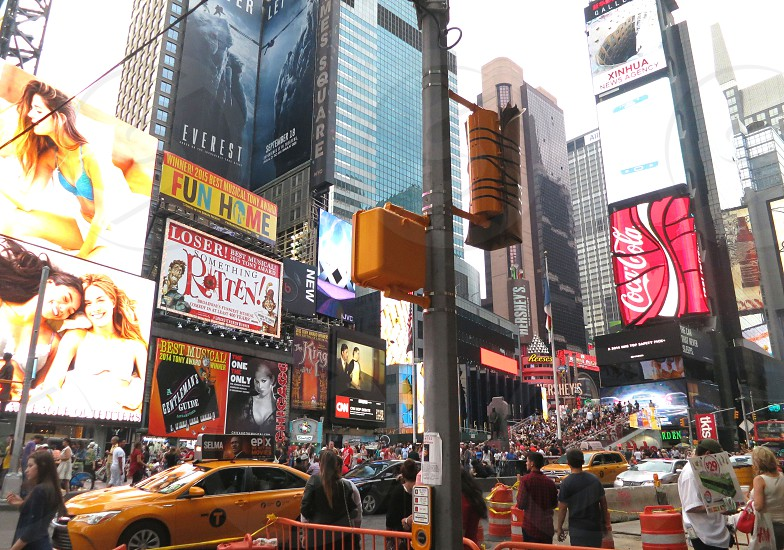 Crowds and traffic in Times Square New York City photo