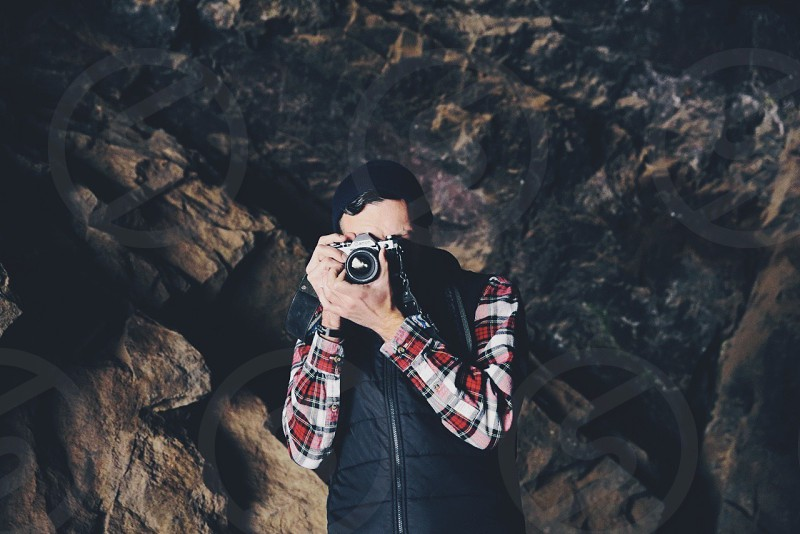 Man taking a photo in a cave photo