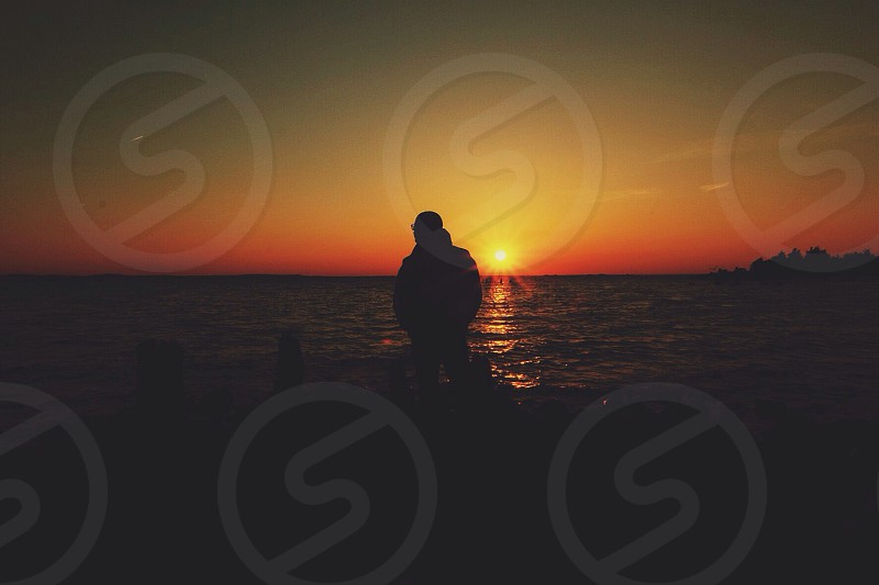 human silhouette at the beach sunset view photography  photo