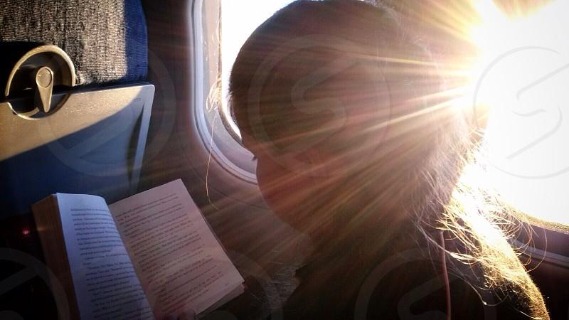 Airplane reading window seat photo