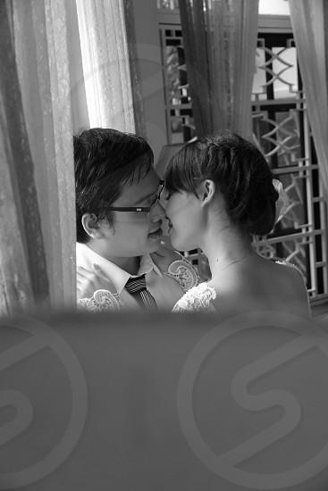 Couple kissing near window Location: Coffee shop photo