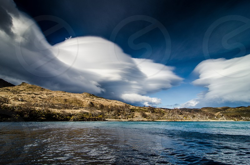 view from Pehoé lake clouds sky lake water colors torres del paine magallanes chile photo