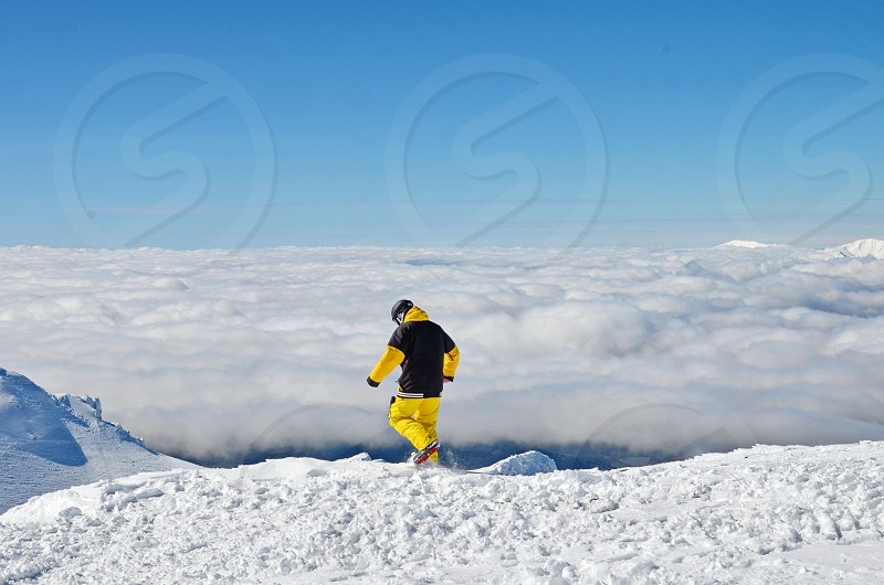 Man trying to find his way in the mountains photo