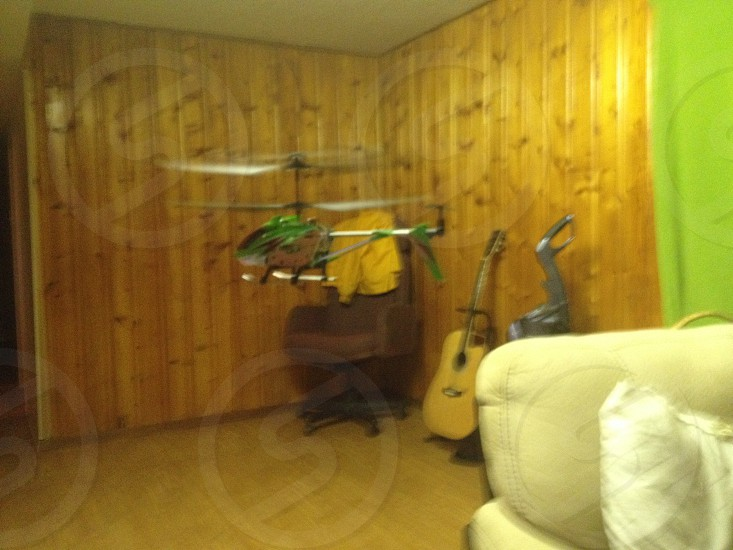 Flying a remote control helicopter and taking a Snapwire photo. That's not as bad as texting and driving is it ? photo