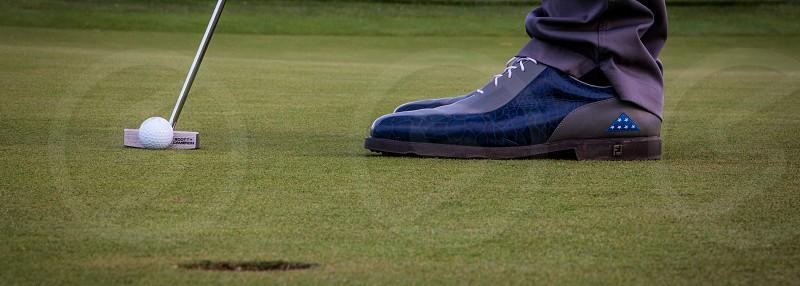 golf putt shoes hole green greens putting golfer land sport photo