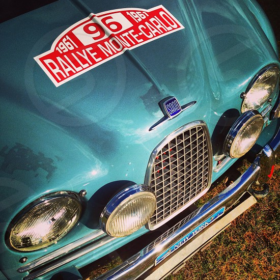 closeup photo of classic teal Saab car photo