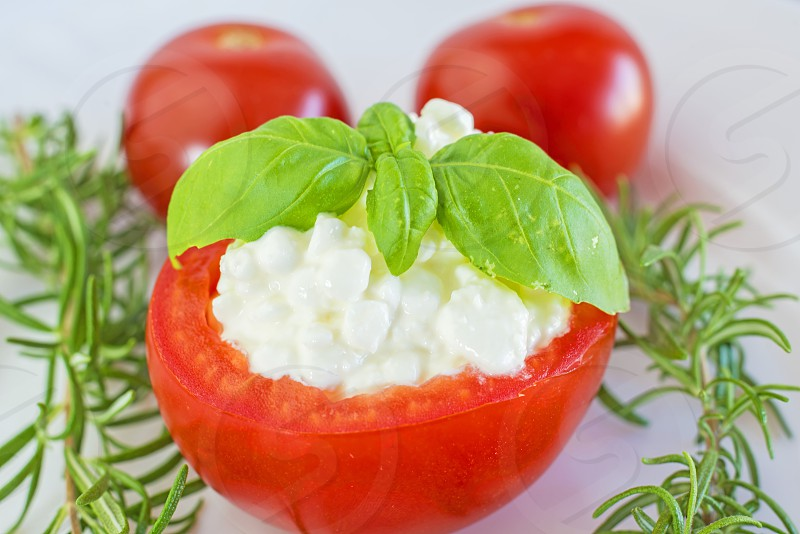 Tomato filled with cheese and basil photo