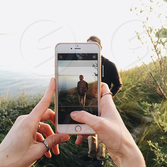 person capturing an image with a man photo