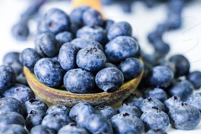 Breakfast time... a spoonful of blueberries  photo