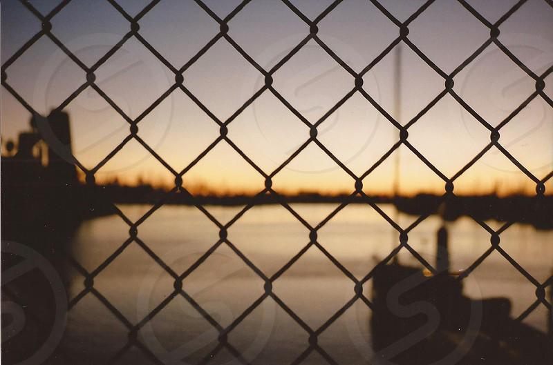 metal fencing body of water behind photo