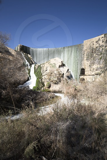 Elche Reservoir is a gravity dam in the shape of an arch photo