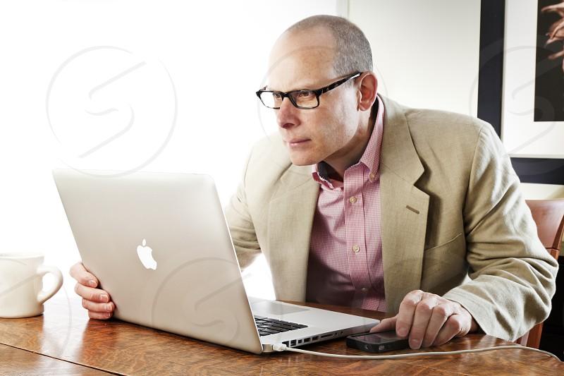 man using his lantop  photo