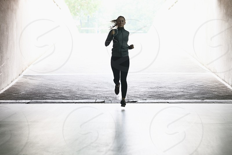 Young woman running in an urban environment photo