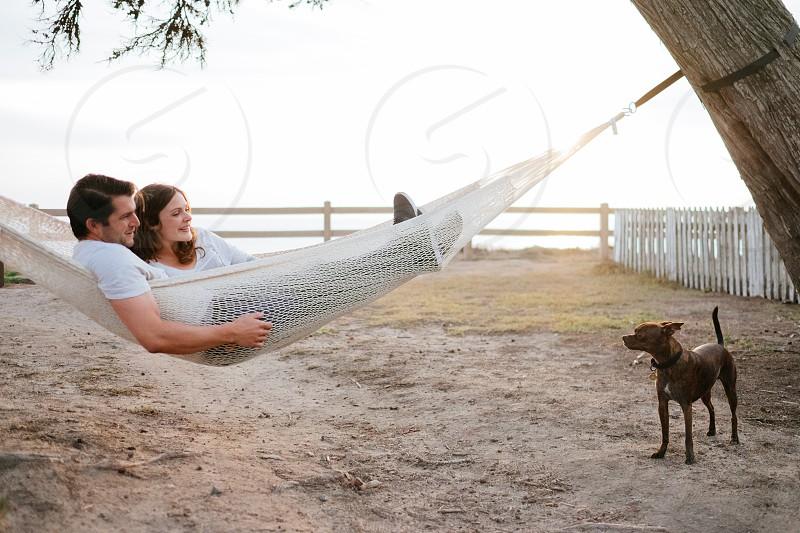 Man woman and dog enjoying a Yellow Leaf Hammock photo