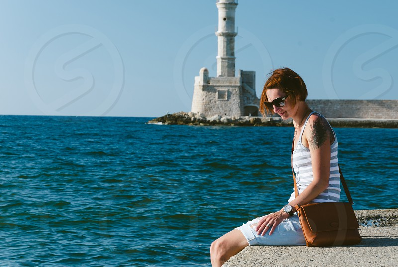 Young woman at Old Town Harbour Chania Crete photo