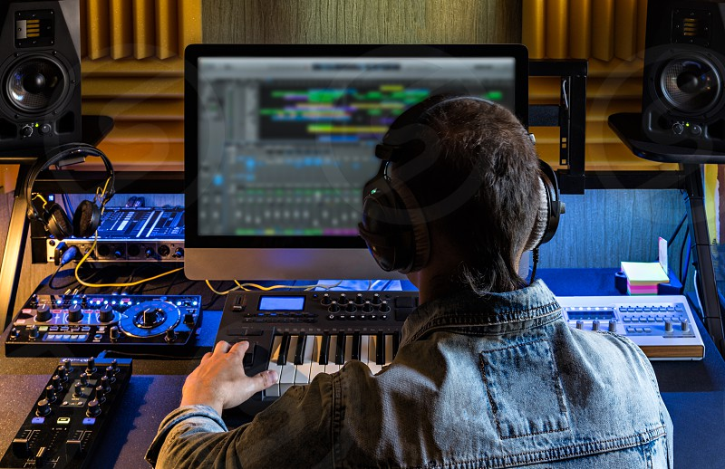 Man produce electronic music in project home studio. photo