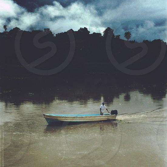 man on speed boat photo