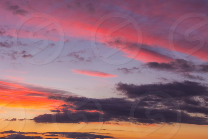 Stunning multiple colors of clouds on a sunset sky photo
