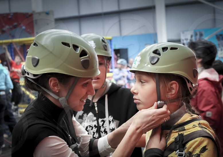 woman and girl wearing a helmet photo