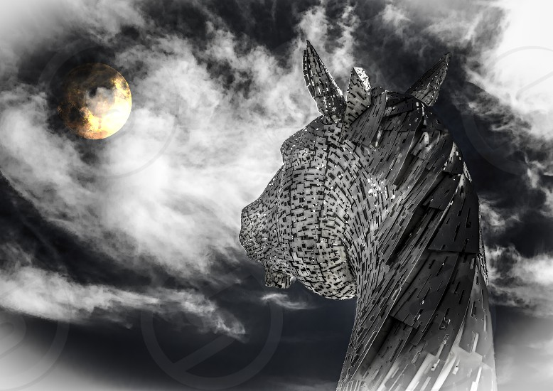 The Kelpies are a well-known Scottish landmark created in 2013 by sculptor Andy Scott. Soaring 30 metres in to the sky above the Forth and Clyde Canal outside Edinburgh the sculptures represent both the beauty of the mythical water-borne creature known as the Kelpie and the power and strength of the magnificent horses which are a central part of the industrial heritage of Scotland. photo