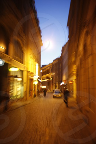 a street in the old town in the city of riga in latvia in the baltic region in europe. photo