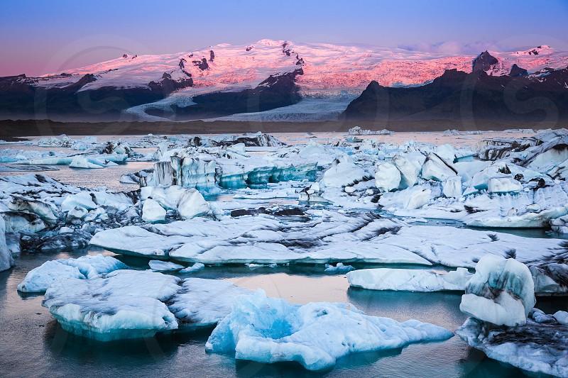 Sunrise at the Jökulsárlón glacier lagoon in south Iceland. photo