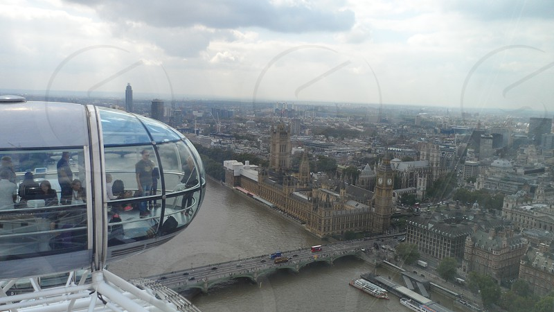 View of the houses of parliament and reflection of the clouds on the london eye pod photo