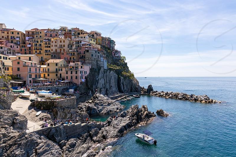 MANAROLA LIGURIA/ITALY  - APRIL 20 : Coastal view of Manarola Liguria Italy on April 20 2019. Unidentified people photo