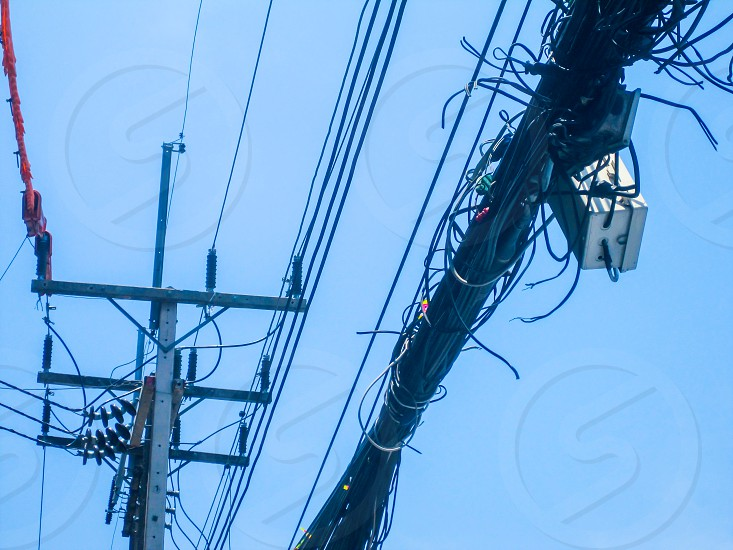 Chaos of cables and wires on an electric pole Thailand photo