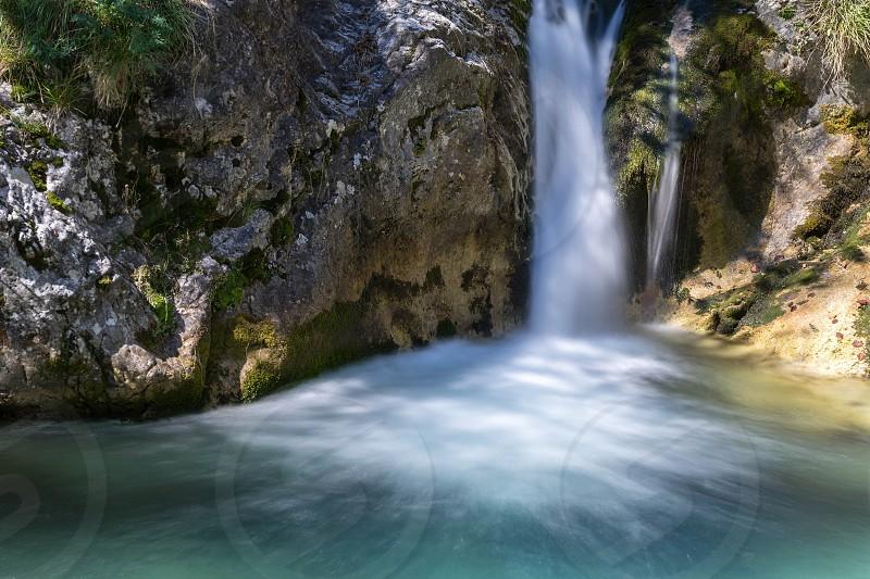 Waterfall at the Val Vertova Torrent Lombardy near Bergamo in Italy photo