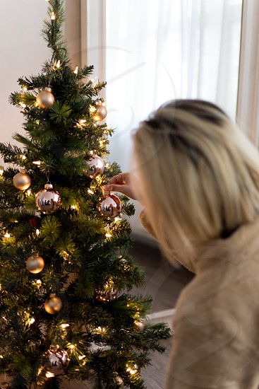 Holiday Celebrations - Christmas shopping and decoration the tree.   Millennial Life - going to a coffee shop reading a book. photo