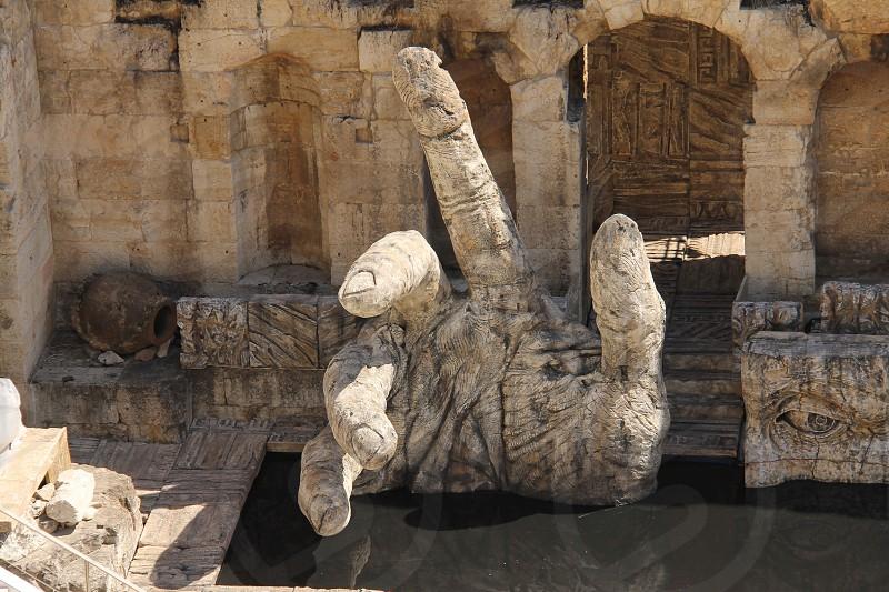 gray hand statue photo