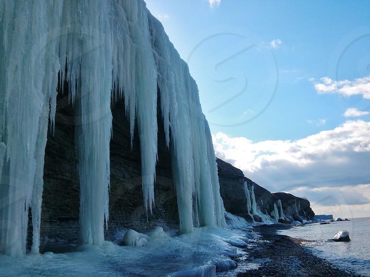 icicles on cliff near the seashore photo